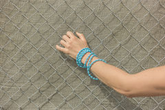 Hand of woman grabbing fence Stock Image