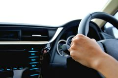 Hand of the woman hold the control wheel and drive the car stock photo
