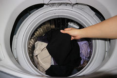 Hand of woman hold fabric for clean. In washing machine Stock Photo