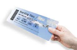 Hand of a woman holding a airplane ticket to New York - image is Royalty Free Stock Photography