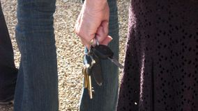 Hand of a woman holding bunch of keys Royalty Free Stock Image
