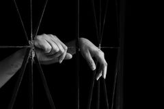 Hand of woman holding cage, abuse, human trafficking concept. With black shadow in whtie tone royalty free stock image