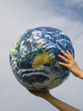 Hand of a woman holding earth Stock Photo