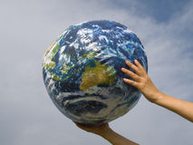 Hand of a woman holding earth stock photography