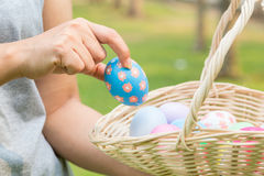 Hand of woman holding easter eggs Stock Images