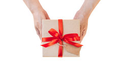 Hand woman holding gift box on isolated with clipping path. Imag Royalty Free Stock Images