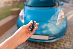 Hand of woman holding key for car Royalty Free Stock Image
