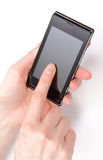 Hand of woman holding mobile phone and touching blank screen Stock Photography