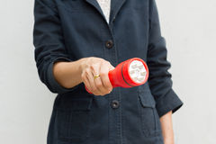 Hand of woman holding red flashlight Stock Image