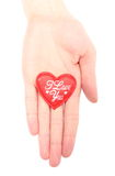 Hand of woman holding red heart. White background Royalty Free Stock Photography
