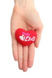Hand of woman holding red heart. White background Stock Photos