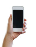 Hand of woman holding a smartphone isolated on white background. Stock Image