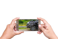 Hand of woman holding smartphone and take photo of car accident. Stock Photography