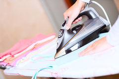 Hand of woman ironing clothes angled Stock Photography