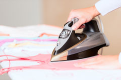 Hand of woman ironing clothes macro Royalty Free Stock Photos