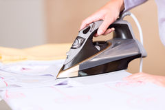 Hand of woman ironing clothes Royalty Free Stock Photo
