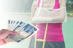 hand woman with Japanese currency yen bank notes on blurred back stock image