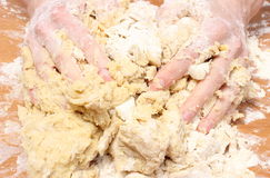 Hand of woman kneading dough for yeast cake Stock Photo