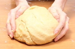 Hand of woman kneading dough for yeast cake Royalty Free Stock Images