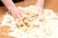 Hand of woman kneading dough for yeast cake Royalty Free Stock Image