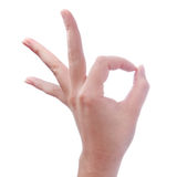 Hand of woman making gesture ok or okay on white Stock Photos
