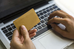 Hand of a woman making purchases through the Internet, keyboard and the card Stock Images