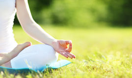 Hand of woman meditating in lotus position practicing yoga Stock Photography