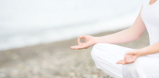 Hand of  woman meditating in a yoga pose on beach Stock Images