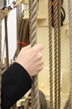 Hand of woman and nautical thick rope on the yacht Royalty Free Stock Photos