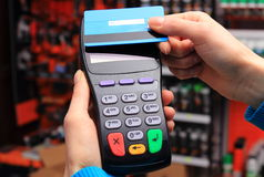 Hand of woman paying with contactless credit card, NFC technology Stock Images