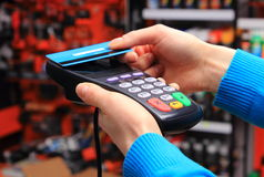 Hand of woman paying with contactless credit card, NFC technology Stock Image