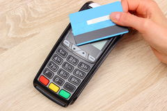 Hand of woman paying with contactless credit card with NFC technology, finance concept Stock Photos