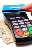 Hand of woman paying with contactless credit card, NFC technology Royalty Free Stock Photos
