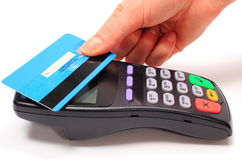 Hand of woman paying with contactless credit card, NFC technology Stock Photos