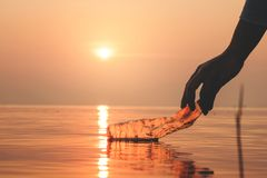 Hand Woman picking up empty of plastic bottle cleaning on the beach , volunteer concept. Environmental pollution. Ecological problem royalty free stock photos