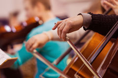 Hand of a woman playing the cello Royalty Free Stock Photo