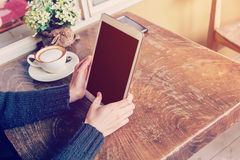 Hand woman playing tablet in coffee shop Stock Photos