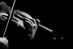Hand of a woman playing violin on black background Royalty Free Stock Images