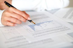 Hand of a woman pointing a graph Stock Photos