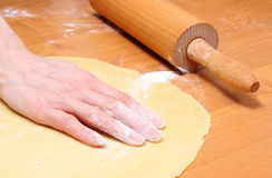 Hand of woman preparing dough for yeast cake Stock Photography