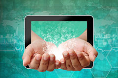 Hand woman pushing out of tablet-pc Royalty Free Stock Images