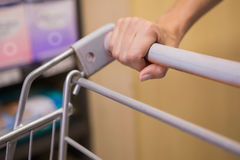 Hand of woman putting on trolley Royalty Free Stock Photo
