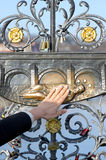 Hand of a woman reaches for a memorial in Prague Charles Bridge Royalty Free Stock Photography