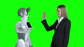 Hand of a woman and a robot hand give five. Green screen. Hand of a woman and a robot hand give five in a studio. Green screen stock video footage