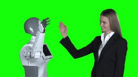 Hand of a woman and a robot hand give five . Green screen. Slow motion. Hand of a woman and a robot hand give five in a studio. Green screen. Slow motion stock footage