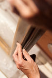 Hand of a woman sanding fixtures Royalty Free Stock Photography