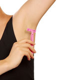 Hand woman shaves armpit disposable razor isolated on white. Royalty Free Stock Photography