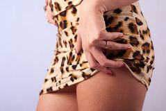Hand on thigh Stock Images