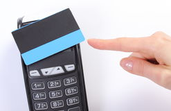 Hand of woman showing payment terminal with contactless credit card Royalty Free Stock Images