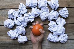 Hand of a woman squeezing a stress ball with crumpled paper stock photography